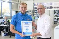 Ola Sjölin, CEO for AxIndustries presents Daniel Wild with his 10 Year Service Award
